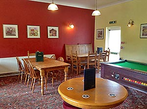 family room in the pub with pool table